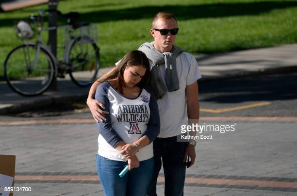 Xavier Brezniak right and Emily Nava gather with a small crowd on the west steps of the state capitol to join the Colorado Coalition Against Gun...