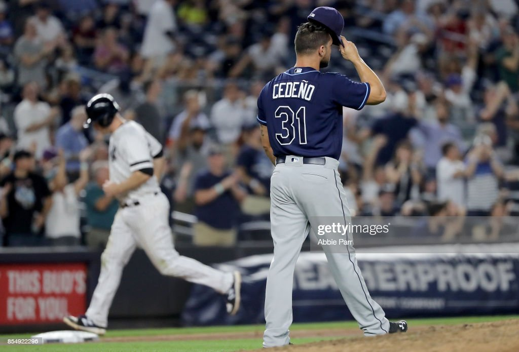 Xavier Cedeno #31 of the Tampa Bay Rays reacts after giving up a two run home run to Aaron Hicks #31 of the New York Yankees in the sixth inning at Yankee Stadium on September 27, 2017 in the Bronx borough of New York City.