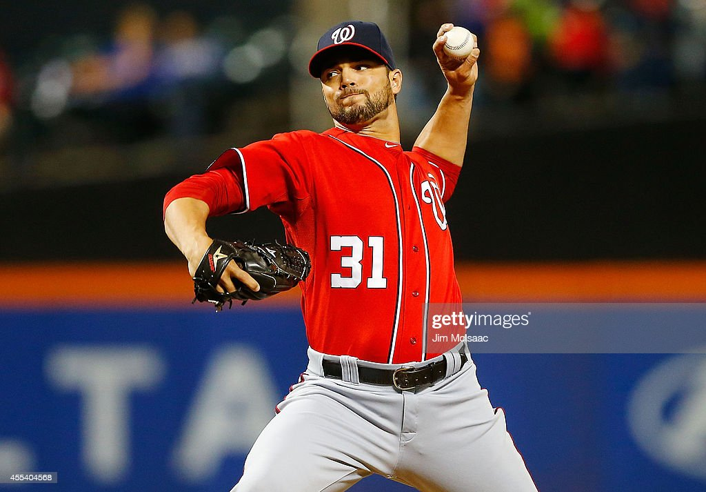 Xavier Cedeno #31 of the Washington Nationals pitches in the ninth inning against the New York Mets at Citi Field on September 13, 2014 in the Flushing neighborhood of the Queens borough of New York City.