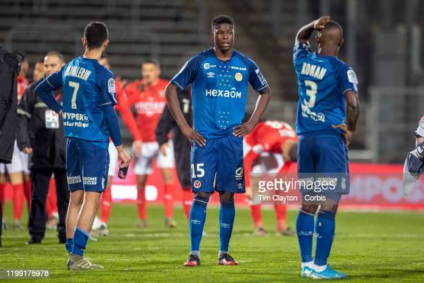 January 11: Xavier Chavalerin of Reims, Marshall Munetsi of Reims and Ghislain Konan of Reims reacts at the final whistle after their loss during the...