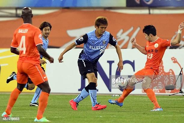 Xavier Chen of Guizhou Renhe and Junichi Inamoto of Kawasaki Frontale battle for the ball during the Asian Champions League match between Guizhou...