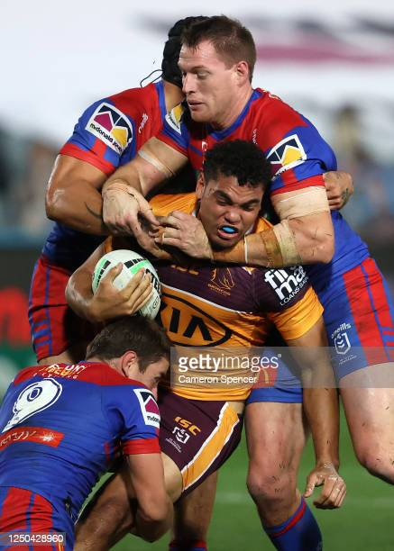 Xavier Coates of the Broncos is tackled during the round six NRL match between the Newcastle Knights and the Brisbane Broncos at Central Coast...