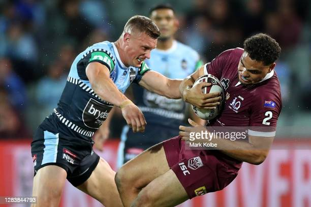 Xavier Coates of the Maroons is tackled by Jack Wighton of the Blues during game one of the 2020 State of Origin series between the Queensland...