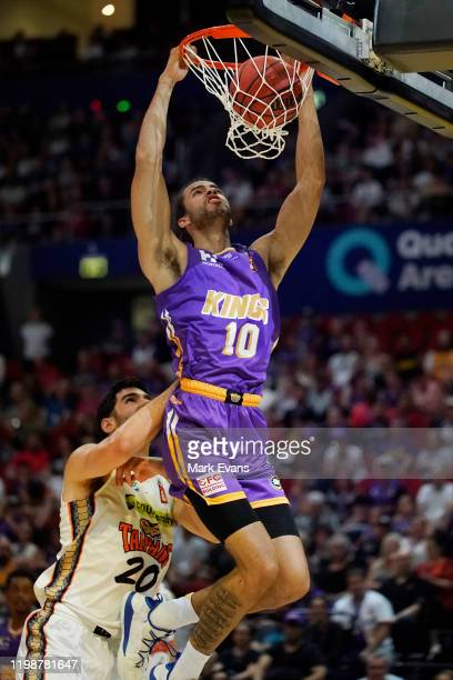 Xavier Cooks of the Kings slam dunks during the round 15 NBL match between the Sydney Kings and the Cairns Taipans at Qudos Bank Arena on January 11...