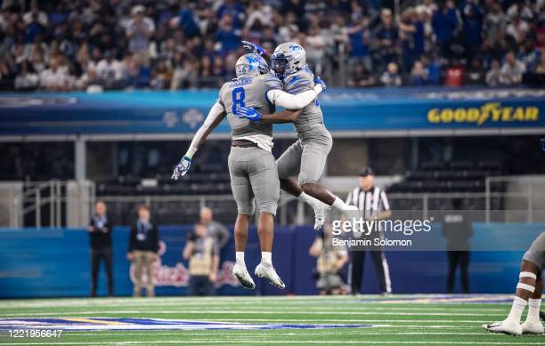Xavier Cullens and Jacobi Francis of the Memphis Tigers celebrate during the Goodyear Cotton Bowl Classic at ATT Stadium on December 28 2019 in...