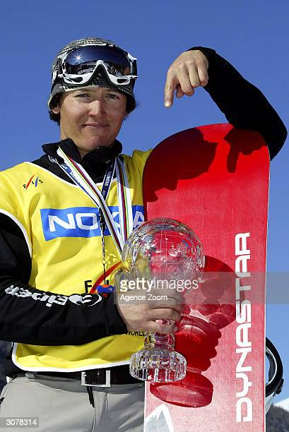 Xavier Delerue of France celebrates victory in the FIS World Cup Mens Snowboardcross final on March 11, 2004 in Bardonecchia, Italy.