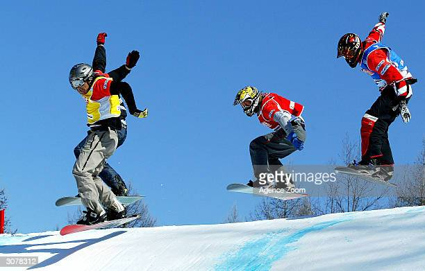 Xavier Delerue of France competes in the FIS World Cup Mens Snowboardcross final with Guillaume Sachot and Aymerick Mermoz of France on March 11,...
