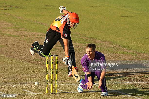 Xavier Doherty of the Hurricanes receives the ball at the non strikers end as Nathan CoulterNile of the Scorchers makes his ground during the Big...