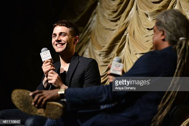 Xavier Dolan and Elvis Mitchell attend the Film Independent at LACMA screening and QA of 'Mommy' at Bing Theatre At LACMA on January 6 2015 in Los...