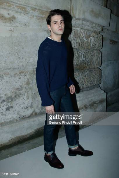 Xavier Dolan attends the Louis Vuitton show as part of the Paris Fashion Week Womenswear Fall/Winter 2018/2019 on March 6 2018 in Paris France