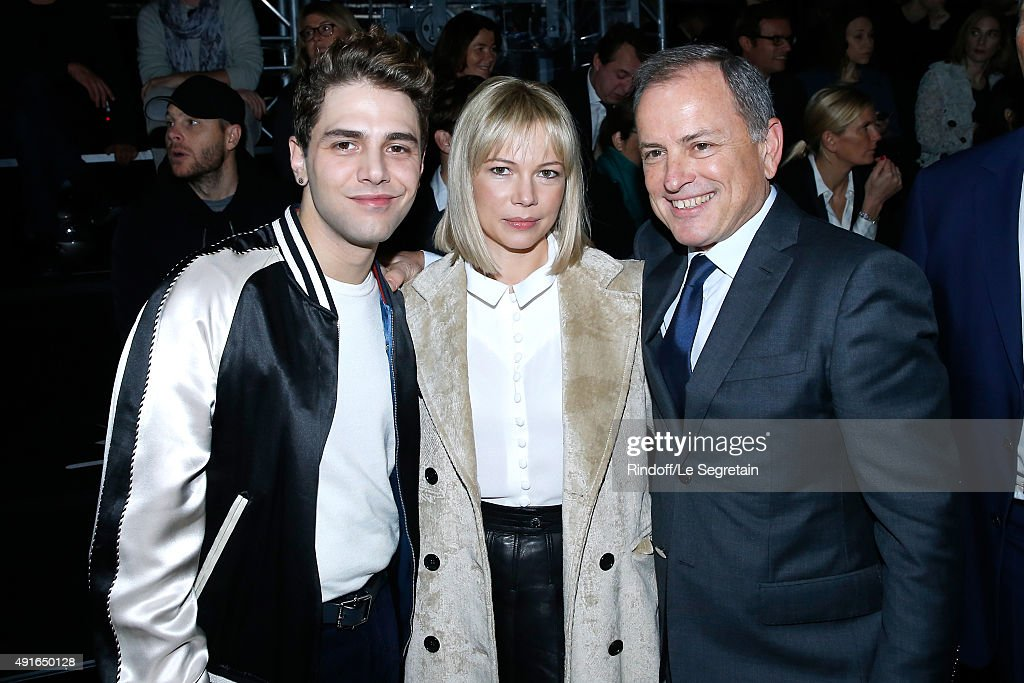 Xavier Dolan, Michelle Williams and Chairman and Chief Executive Officer of Louis Vuitton, Michael Burke attend the Louis Vuitton show as part of the Paris Fashion Week Womenswear Spring/Summer 2016. Held at Louis Vuitton Foundation on October 7, 2015 in Paris, France.