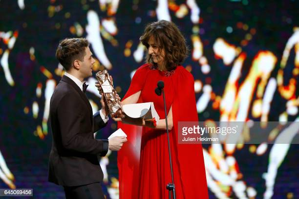 Xavier Dolan receives the Cesar of best actor in 'Juste la fin du monde' in behalf of Gaspard Ulliel on stage during the Cesar Film Awards Ceremony...