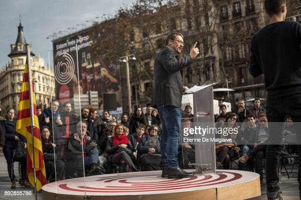 Xavier Domenech candidate for En Comu Podem party delivers a speech at a street meeting on University square on December 14 2017 in Barcelona Spain
