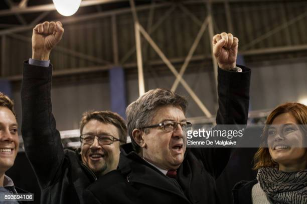 Xavier Domenech candidate for En Comu Podem party raises fist with French Jean Luc Melenchon leader of Les Insoumis movement after a meeting of En...