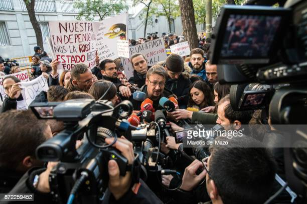Xavier Domenech speaks to the press as Carme Forcadell arrives at Supreme Court to be questioned over her role in Catalonia's independence