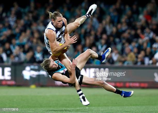 Xavier Duursma of the Power and Mark Blicavs of the Cats collide during the AFL First Qualifying Final match between the Port Adelaide Power and the...