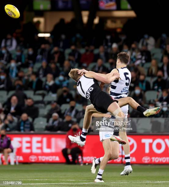 Xavier Duursma of the Power clashes with Jeremy Cameron of the Cats during the 2021 AFL Round 23 match between the Adelaide Crows and the North...