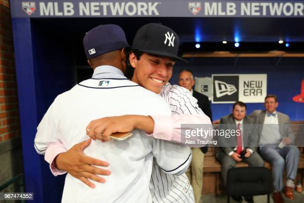 Xavier Edwards hugs 23rd overall pick Anthony Seigler after being selected 38th overall by the San Diego Padres during the 2018 Major League Baseball...