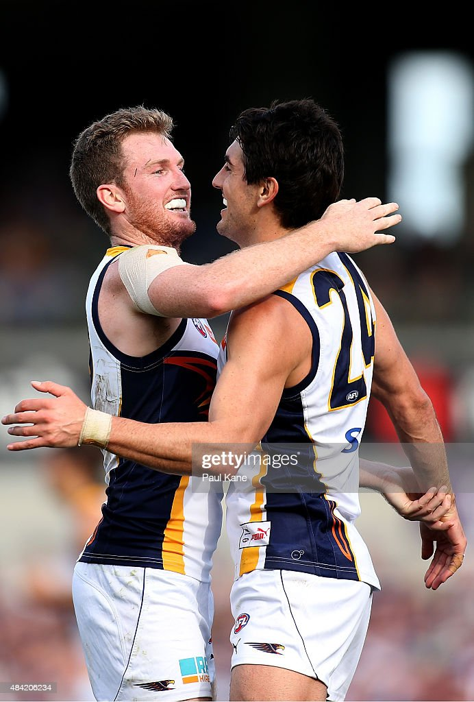 Xavier Ellis and Matt Rosa of the Eagles celebrate a goal during the round 20 AFL match between the Fremantle Dockers and the West Coast Eagles at Domain Stadium on August 16, 2015 in Perth, Australia.