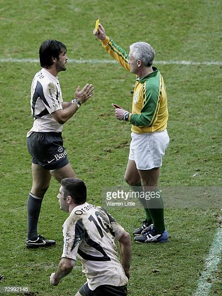 Xavier Garbajosa of Toulouse is given a yellow card by Referee Alan Lewis during the Heineken Cup round five match between London Irish and Toulouse...