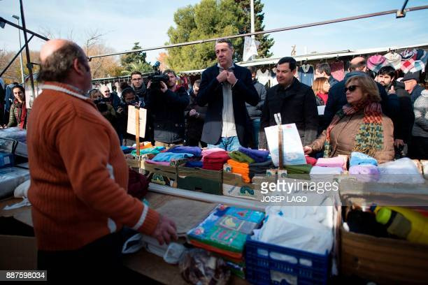 Xavier Garcia Albiol People's Party of Catalonia leader and candidate in the upcoming December 21 Catalan election speaks to a vendor next to...