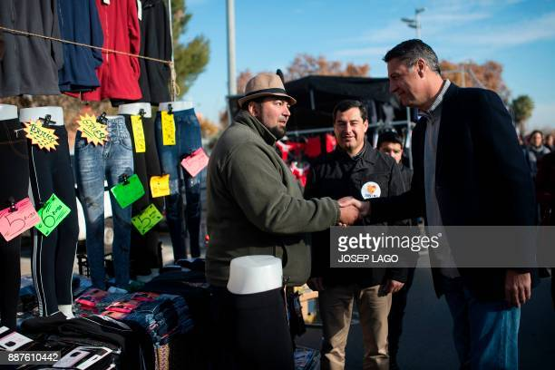 Xavier Garcia Albiol People's Party of Catalonia leader and candidate in the upcoming December 21 Catalan election shakes hands with a vendor next to...
