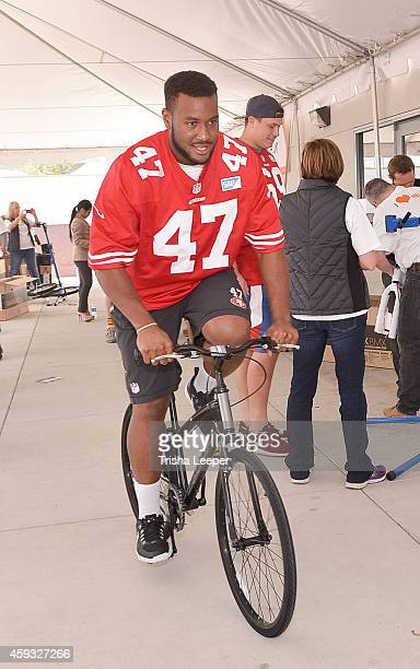 Xavier Grimble attends San Francisco 49ers Team Up With Turning Wheels For Kids To Build Bikes For Kids at Levi's Stadium on November 10, 2014 in...
