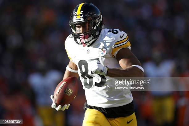 Xavier Grimble of the Pittsburgh Steelers carries the ball against the Denver Broncos at Broncos Stadium at Mile High on November 25, 2018 in Denver,...