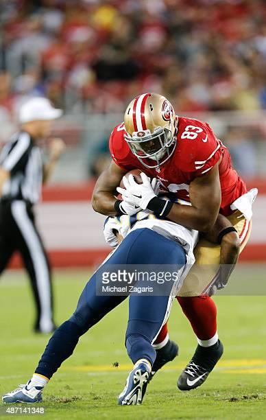 Xavier Grimble of the San Francisco 49ers gets tackled after making a reception during the game against the San Diego Chargers at Levi Stadium on...