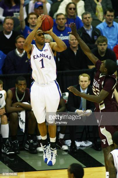 Xavier Henry of the Kansas Jayhawks shoots a three pointer against the Texas AM Aggies during the semifinals of the 2010 Phillips 66 Big 12 Men's...