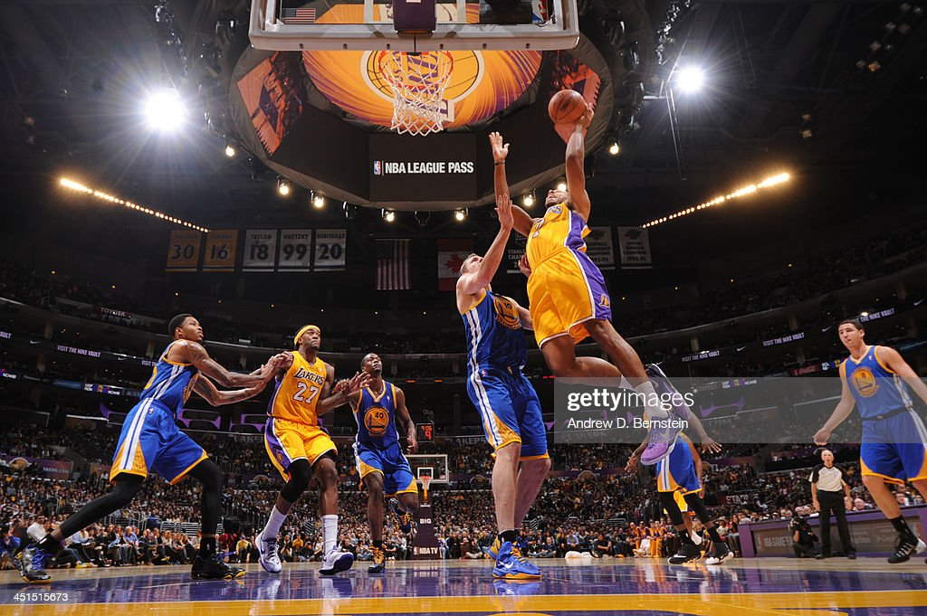 Xavier Henry #7 of the Los Angeles Lakers attempts a shot against David Lee #10 of the Golden State Warriors on November 22, 2013 at STAPLES Center in Los Angeles, California.