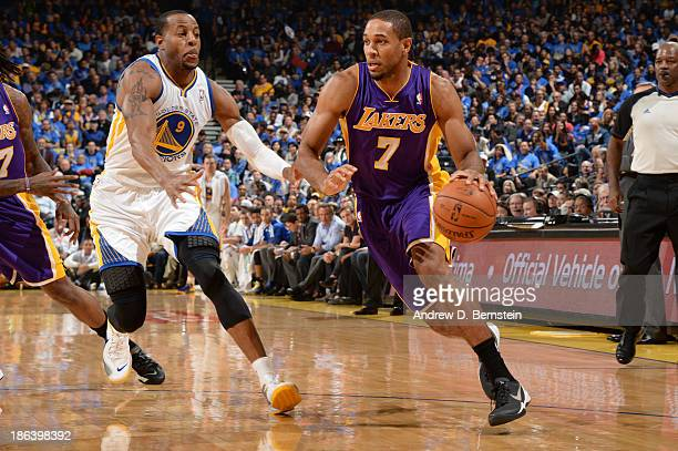 Xavier Henry of the Los Angeles Lakers drives to the basket against Andre Iguodala of the Golden State Warriors at Oracle Arena on October 30 2013 at...