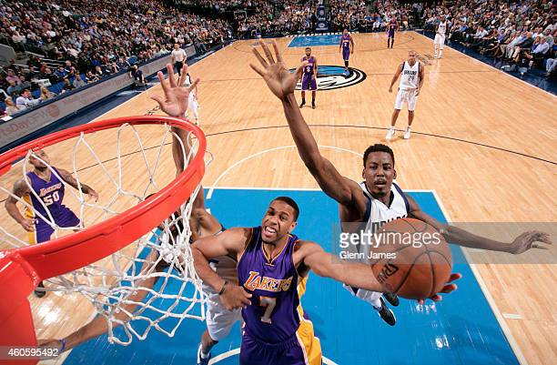 Xavier Henry of the Los Angeles Lakers drives to the basket against the Dallas Mavericks on November 21 2014 at the American Airlines Center in...