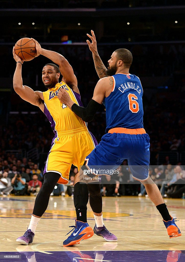 Xavier Henry #7 of the Los Angeles Lakers reacts to the defense of New York Knicks at Staples Center on March 25, 2014 in Los Angeles, California.