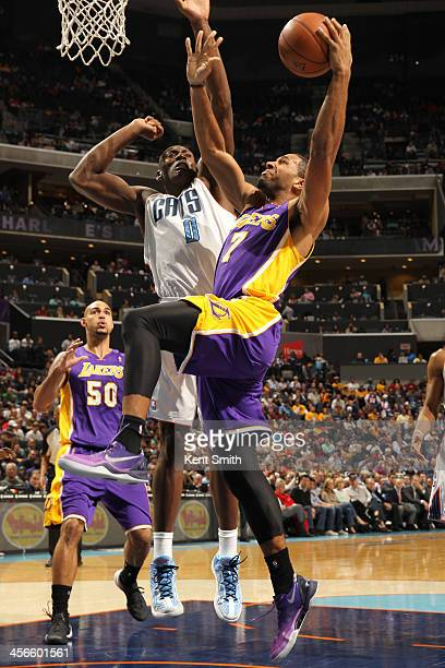 Xavier Henry of the Los Angeles Lakers shoots against Bismack Biyombo of the Charlotte Bobcats during the game at the Time Warner Cable Arena on...