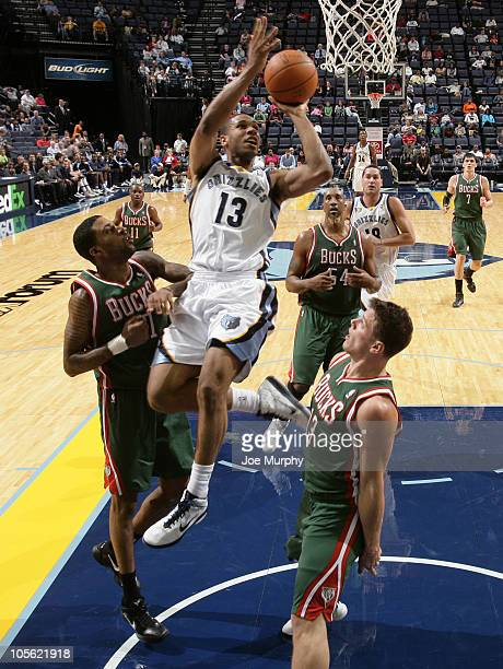Xavier Henry of the Memphis Grizzlies shoots against Chris DouglasRoberts and Chris Kramer of the Milwaukee Bucks on October 16 2010 at the...
