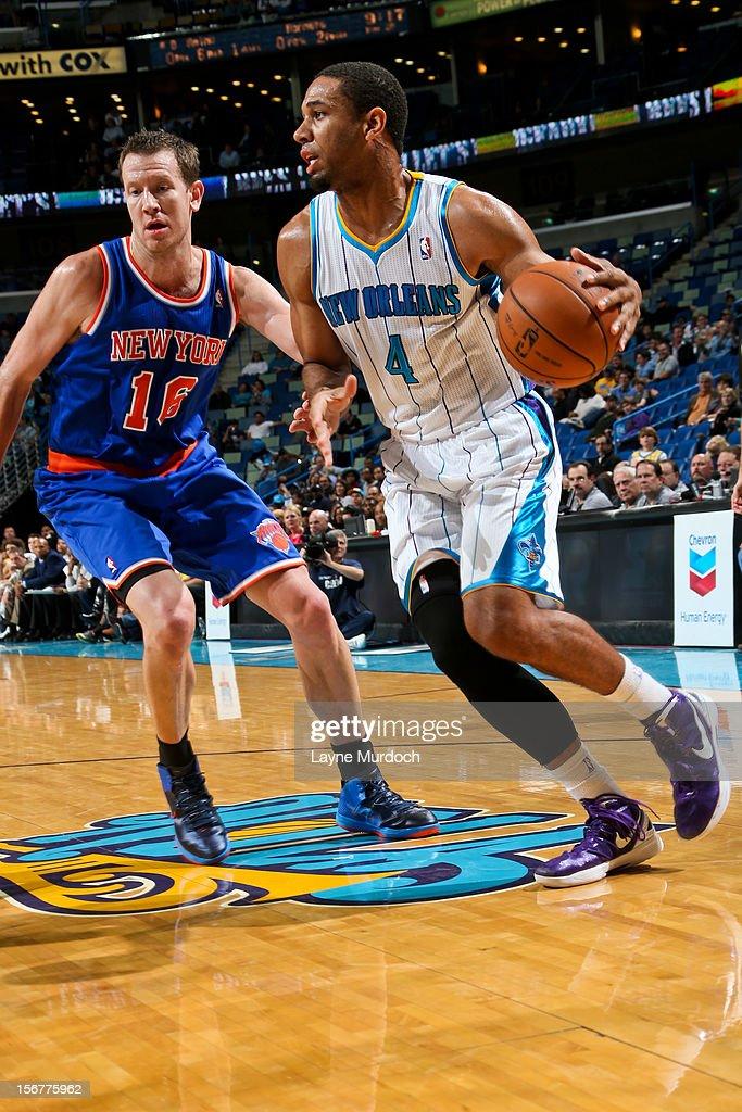 Xavier Henry #4 of the New Orleans Hornets drives against Steve Novak #16 of the New York Knicks on November 20, 2012 at the New Orleans Arena in New Orleans, Louisiana.