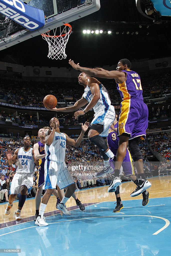 Xavier Henry #4 of the New Orleans Hornets goes to the basket against Andrew Bynum #17 of the Los Angeles Lakers on April 9, 2012 at the New Orleans Arena in New Orleans, Louisiana.