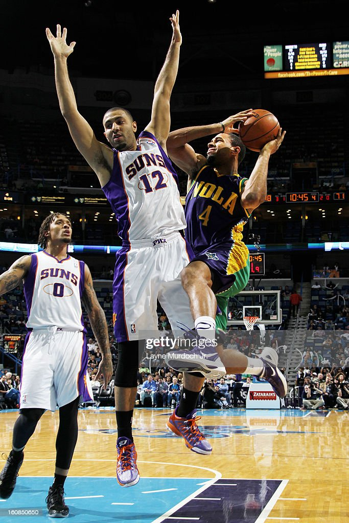 Xavier Henry #4 of the New Orleans Hornets goes to the basket against Kendall Marshall #12 of the Phoenix Suns on February 06, 2013 at the New Orleans Arena in New Orleans, Louisiana.