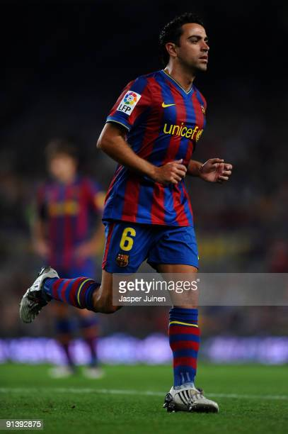 Xavier Hernandez of Barcelona in action wearing special boots promoting 'FIFA 10' during the La Liga match between Barcelona and Almeria at the Camp...
