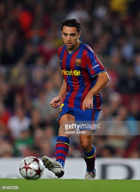 Xavier Hernandez of Barcelona runs with the ball during the Champions League group F match between Barcelona and Dynamo Kiev at the Camp Nou Stadium...