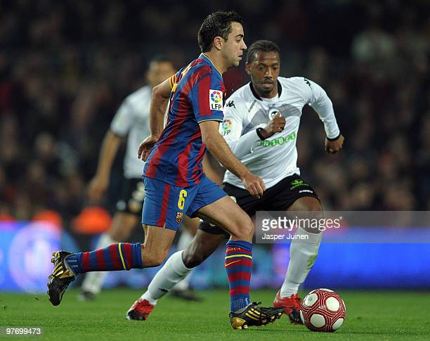 Xavier Hernandez of FC Barcelona duels for the ball with Manuel Fernandes of Valencia during the La Liga match between Barcelona and Valencia at the...