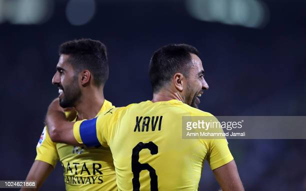 Xavier Hernandez Xavi and Akram Hassan Afif of Al Sadd celebrate after the second goal during the AFC Champions League match between Al Esteghlal and...