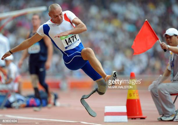 Xavier le Draollec of France is red flagged for the third time and disqualified from the final of the men's long jump F4244 classification event at...