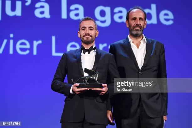 Xavier Legrand and Alexandre Gavras receive the 'Luigi De Laurentiis' Venice Award for a Debut Film Award fore 'Jusqu'à la Garde' during the Award...