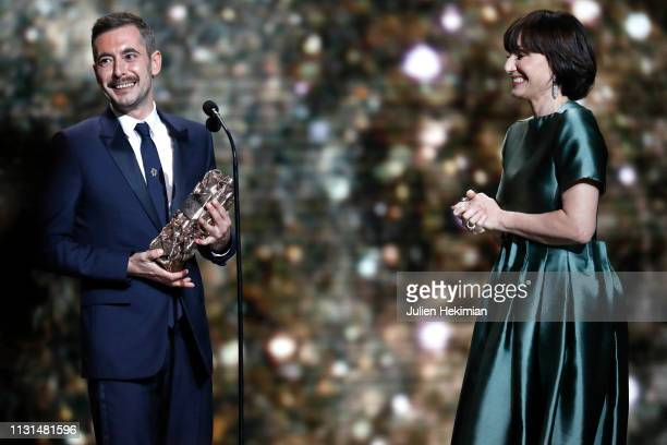 "Xavier Legrand receives the Cesar award for Best Film for ""Jusqu'a la garde"" from Kristin Scott Thomas, during Cesar Film Awards 2019 at Salle Pleyel..."