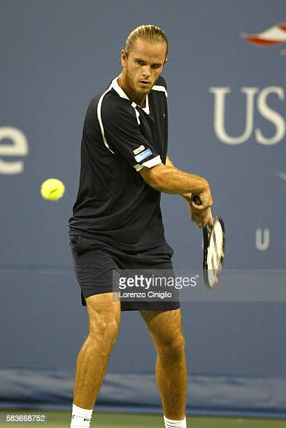 Xavier Malisse competes against Andy Roddick during Day 10 of the US Open Tennis Tournament. Roddick defeated Malisse 6-3, 6-4, 7-6.
