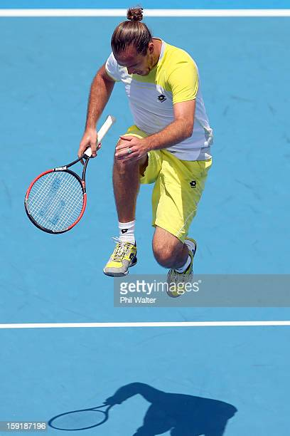 Xavier Malisse of Belgium leaps up off the court in his quarterfinal match against Philipp Kohlschreiber of Germany during day four of the Heineken...
