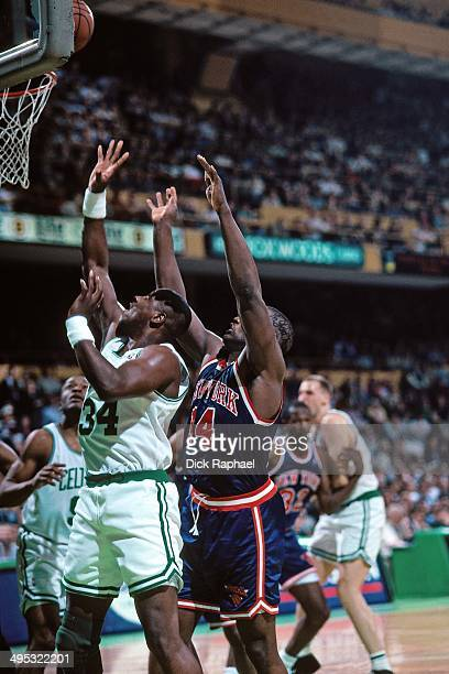 Xavier McDaniel of the Boston Celtics jumps for a rebound against Anthony Mason of the New York Knicks during a game played in 1995 at the Boston...