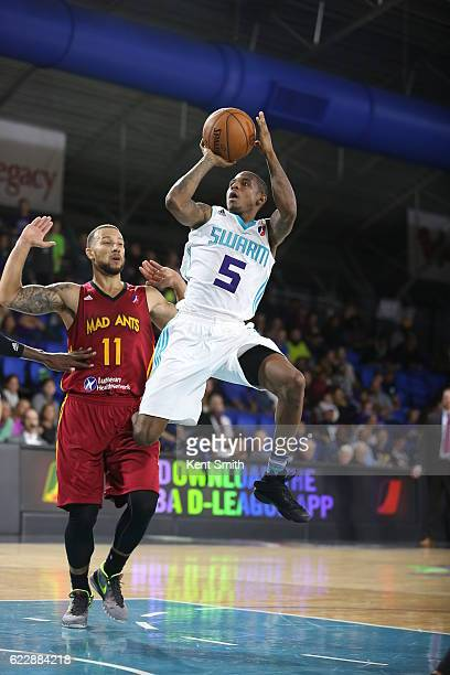 Xavier Munford of the Greensboro Swarm shoots against Trey MckinneyJones of the Fort Wayne Mad Ants during the game at the The Field House at the...